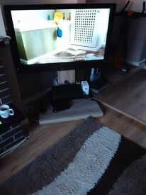 Large TV and new stand