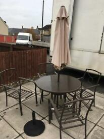 Patio table, chair and parasol set