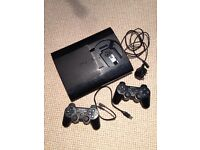 ps3 slim PERFECT WORKING CONDITION + 2 wireless controllers