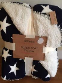 Navy and white star fleece throw