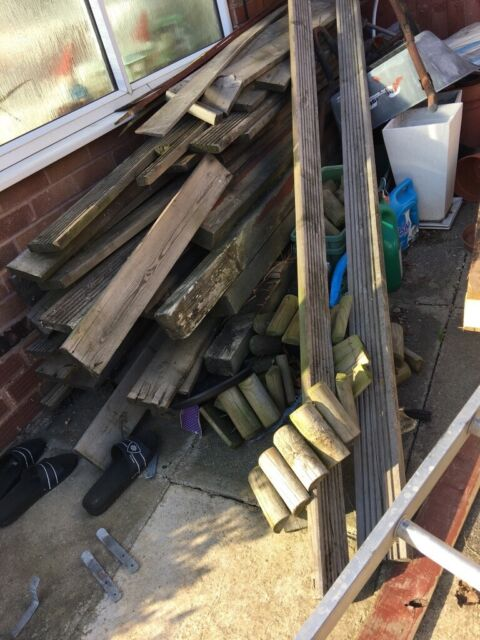 Garden items that consist of , old decking , table and 2