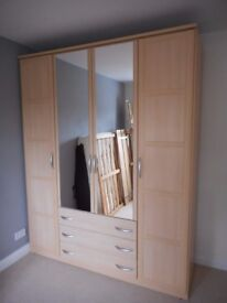 6 foot wide Wardrobe - 4 doors (2 mirrored), 3 drawers. Good quality maple effect from Harveys