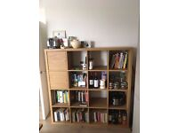 "Ikea ""Kallax"" 4 x 4 bookshelf / storage unit + 2 cupboard insets looking for a good home"