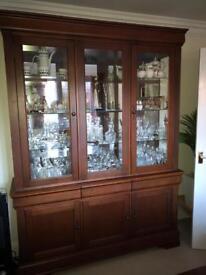 Glazed dark wood veneer large display cabinet with 3 drawers and cupboards below