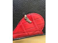 Kitsch Rockabilly black and red leather handbag with heart detail