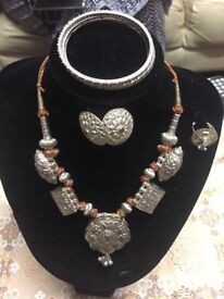 A brand new vintage set of necklace, ear tops, ring and 4 bangles, hand engraved of solid silver