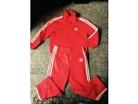 Kids red Adidas tracksuit
