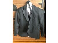 Brand new boys black suit 8-11 years