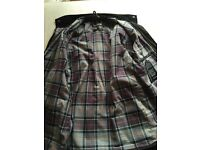 Barbour wax jacket with traditional tartan lining