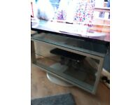 Tv stand glass with a grey base