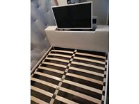 White double bed with tv