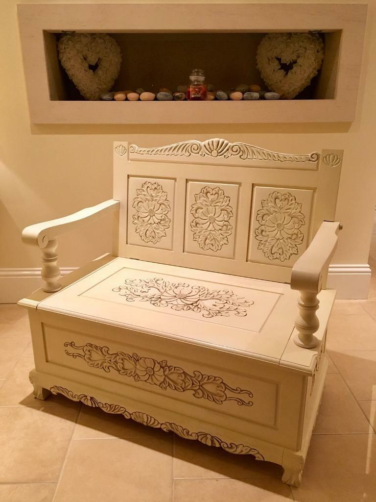 Hand carved two seater bench with storage space underneath