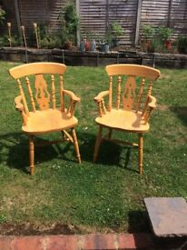 Two Swiss style wooden chairs