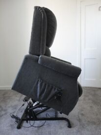 Drive De vilbiss Indiana Motor rise recliner chair in excellent condition , charcoal colour fabric