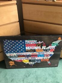 Large wooden print of USA made out of car registrations