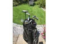 Wilson golf clubs + bag and trolley