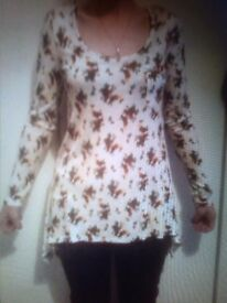 Long flowery drop hem top. Fit 10-14. £4