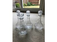 4 glass carafes (decanters, with stoppers)