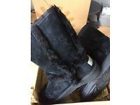 Black furry UGG boots
