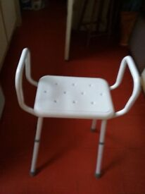 White bathroom or kitchen stool with adjustable height legs