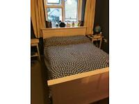 Wooden white double bed frame