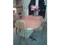 Extending wooden dining table with six chairs