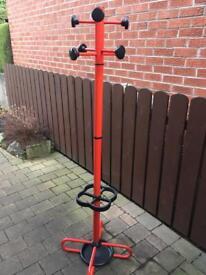Retro red coat and umbrella stand