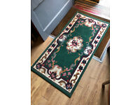 Rug , main colour green. Size 55in x 28in Feel free to view