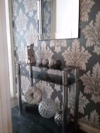Slim black glass and chrome console table