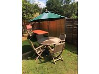 Teak table, 4 x teak chairs, umbrella and stand