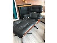 lounge chair with ottoman footstool black leather and rosewood. Retro design.