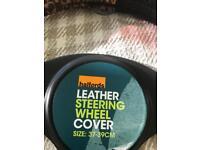 Brand new steering wheel cover. Girl racer Xmas gift.