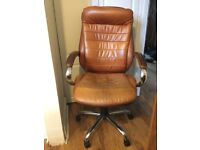 Brown leather swivel chair with wheels good quality
