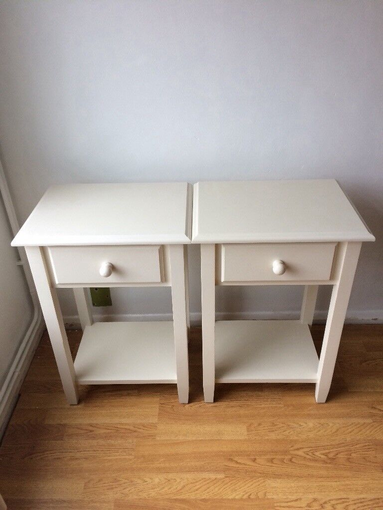 Two wooden bedside tables