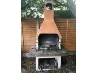 Concrete pizza oven with rotisserie