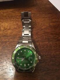 Rolex style watch green face