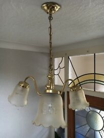 Brass coloured three light fitting with glass shades