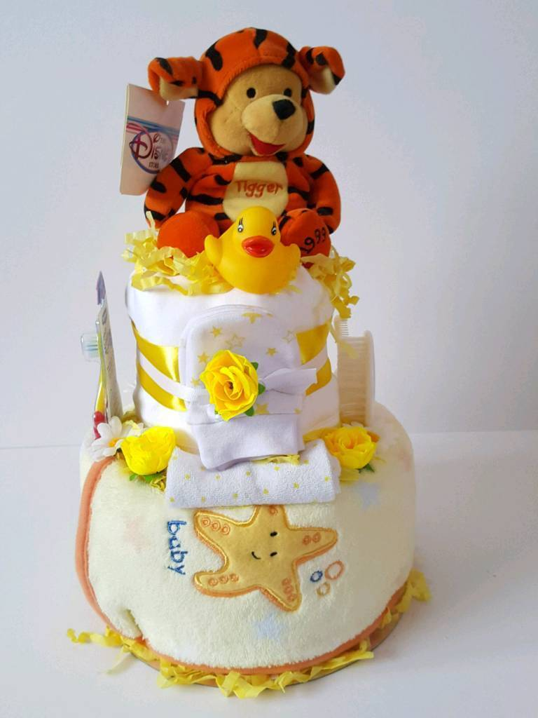 c35f7c751770 Winnie the pooh dressed as tigger 2 tier neutral nappy cake