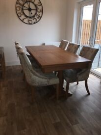Solid oak extending dining table and 6 champagne crushed velvet chairs with knocker