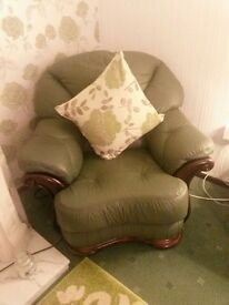 Green leather sofa and x2 chairs with sold wood base
