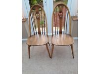 PAIR OF ERCOL SWAN BACK DINING CHAIRS