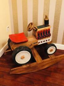 Large wood crafted tractor (rocker)