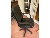 Black faux leather office chair in good condition