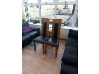 Wood and leather dining chairs and extending table