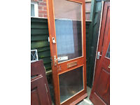 Exterior door with 2 patterned double glazed panels