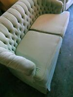 2 light green love seats