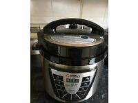 An electric pressure &slow cooker in one