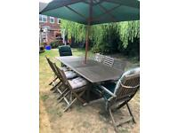 Wooden garden set with 8 chairs