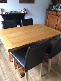 Wooden table ( extendable) with chairs.