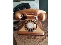 Retro style rotary telephone in copper